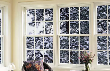 Windows with a snowy tree outside